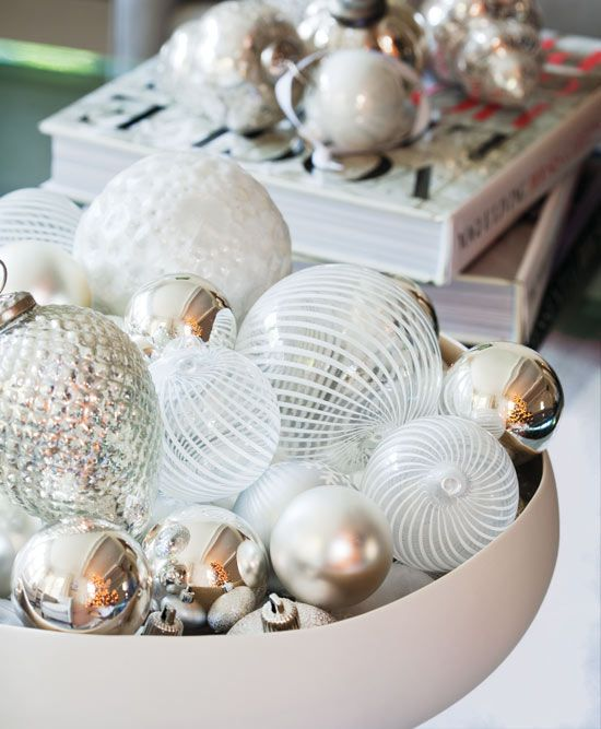 a simple glam display with pearly and shiny ornaments in a bowl