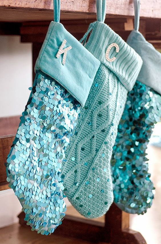 cable knit and sequin blue stockings with monograms are cool for a shiny touch