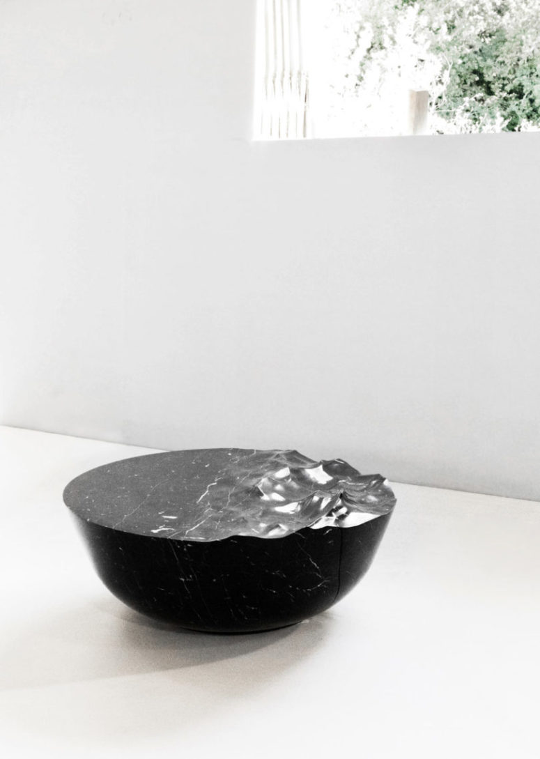Such a coffee table was designed digitally, and it's sure to make a cool statement in any modern space