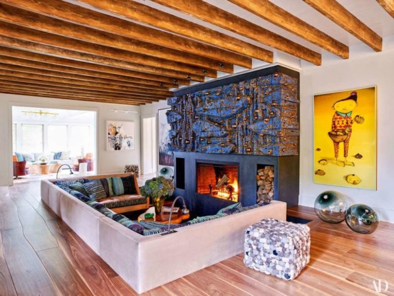 The living room features a sunken conversation pit and a unique fireplace done by an artist