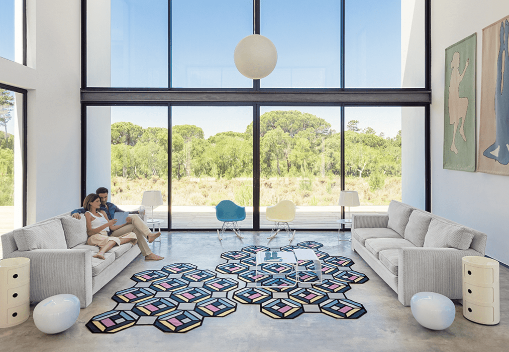 This is Parquet Tetragon rug in blue, pink, grey and black