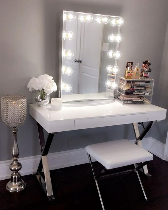 a glam sleek white vanity with metal trestle legs and a drawer for storage