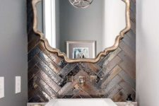 03 a gorgeous statement wall done with metallic tiles of different shades and clad in a herringbone pattern