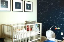 03 a space-themed nursery with a constellation statement wall, fun artworks and a navy pouf