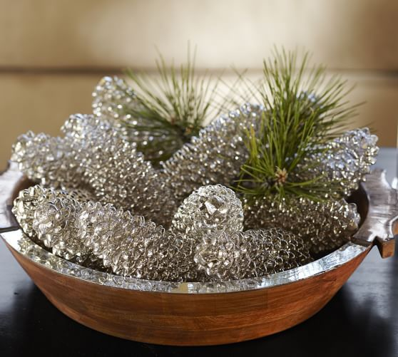 a wooden bowl with silver pinecones and pine branches for a sparkly glam look