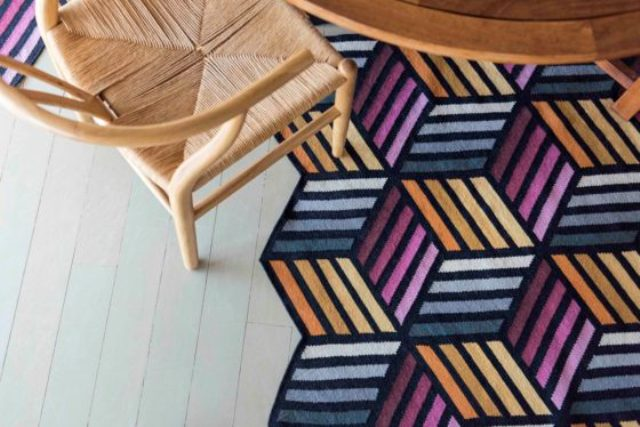 This is Parquet Hexagon rug in shades of grey, yellow and pink
