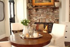04 a cozy breakfast zone by the fireplace with a rich-colored wood pedestal table