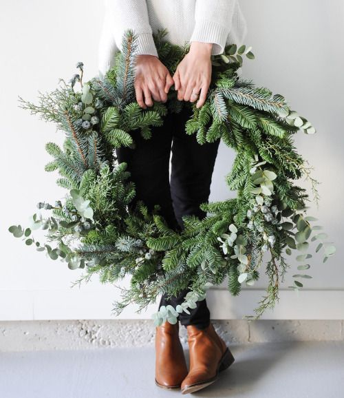 a lush evergreen wreath with no decor will focus on its natural beauty and fit any space