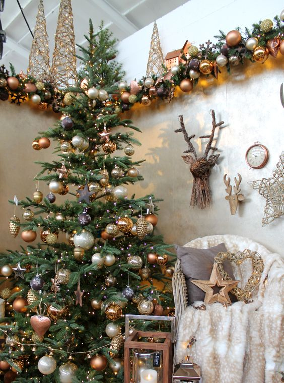 copper, gold and pearl Christmas decor with lots of ornaments looks refined