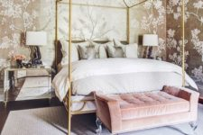 04 gold floral wallpaper, a pink upholstered bench and brass bed framing