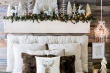 05 a headboard display with deer, shiny Christmas trees, a fir garland and lights