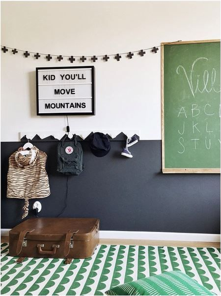 a partly black wall with a mountain pattern for a mountain-themed room