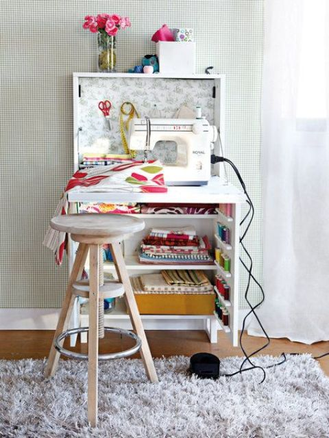 a small sewing nook in a cabinet can be hidden any time and won't take much space