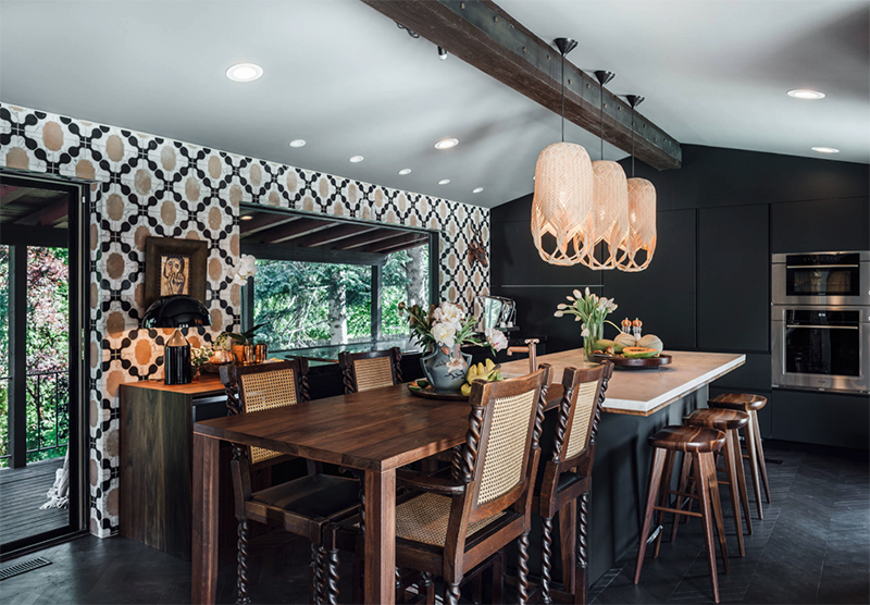 The kitchen is Gothic, there's a geometric walpaper wall and sleek matte black cabinets