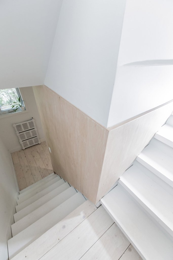 The staircase is whitewashed, and the wood is light-colored too to create an airy feeling