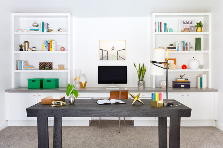 The workspace is light and airy, with built-in furniture and lots of colorful accessories