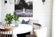 06 a cool farmhouse breakfast nook with a white pedestal table and some wood chairs looks very cozy and inviting