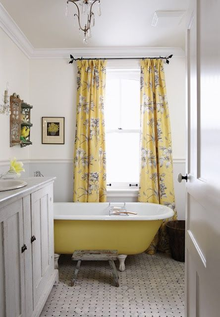 a farmhouse bathroom with yellow floral print curtains