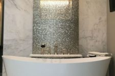 06 a marble statement wall and a shiny penny tile statement to highlight the bathtub
