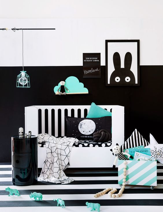 a partly black and white wall makes a bold accent and mint touches make the room fresher