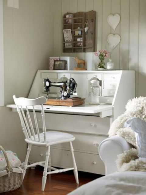 a vintage-inspired sewing nook in white with small and cute details can be placed in the bedroom