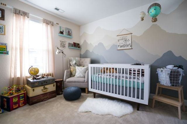 adventure-inspired nursery in grey and green shades with lots of fun decor