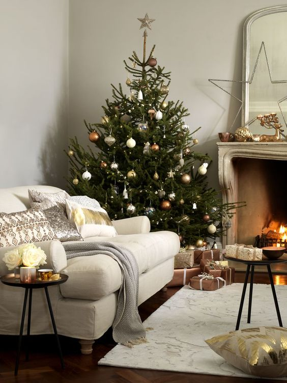 copper, silver and gold ornaments of various shapes make the tree very chic