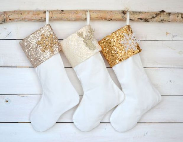 white stockings with cream, champagne and gold sequin tops and deer and snowflake appliques