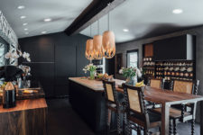 07 Rich-colored wood touches, eye-catchy stools and pendant lamps over the kitchen island add eye-catchiness to the space