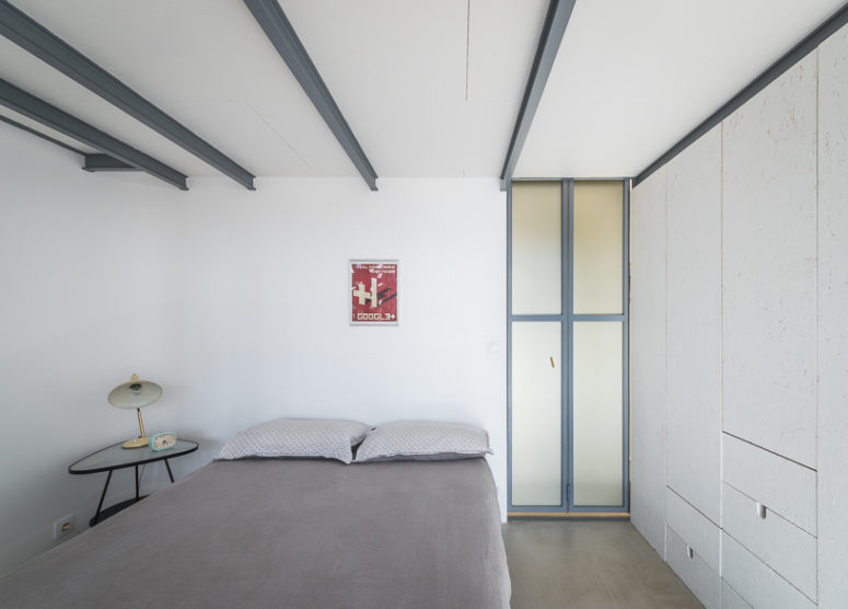 The master bedroom inside is done in white, with sleek white cabinets