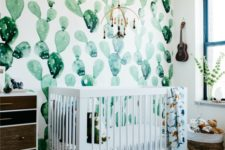 07 a desert-themed nursery with a watercolor cactus wall, a reclaimed wood dresser