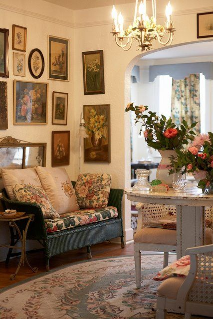 a floral rug, upholstery and pillows add English chic to the space