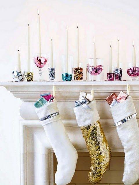 a glam display with shiny colorful candle holders and sequin stockings plus colorful gifts