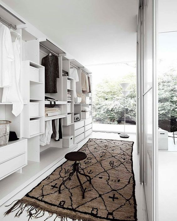 a large closet with lots of cabinets and large windows to brign much light in