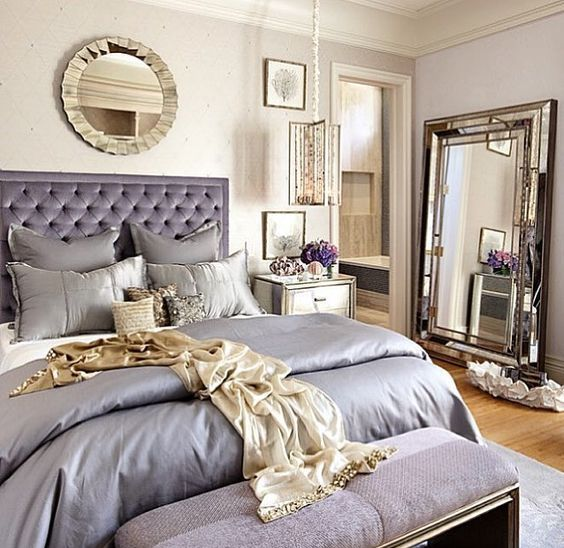 a neutral bedroom with lavender touches and lots of shiny mirrors to make the space glam