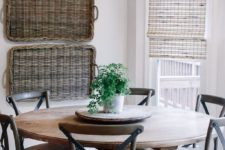 07 a rustic space with baskets on the wall, a wooden dining set and some neutral Roman shades