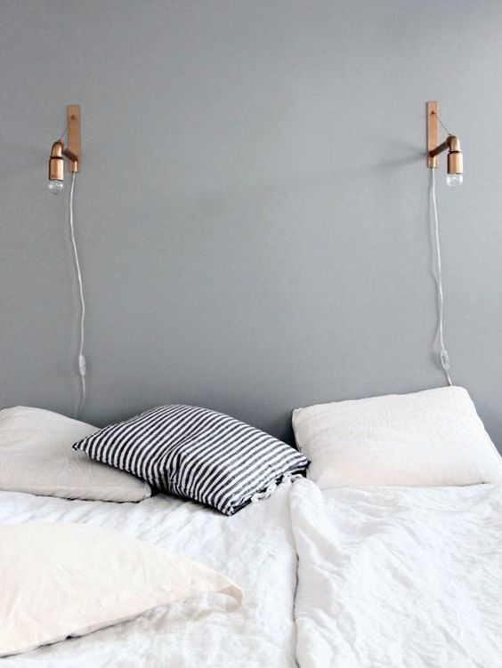 an industrial copper sconce is a great idea for lots of bedrooms and they add a chic touch