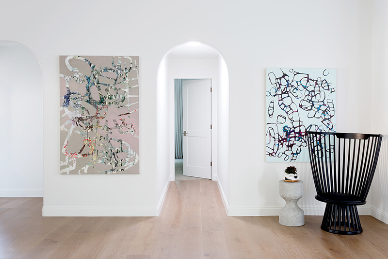 Colorful modern artoworks add a chic touch to the space