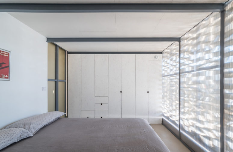 If the owners open the aluminum panels, there will be much light in the bedroom