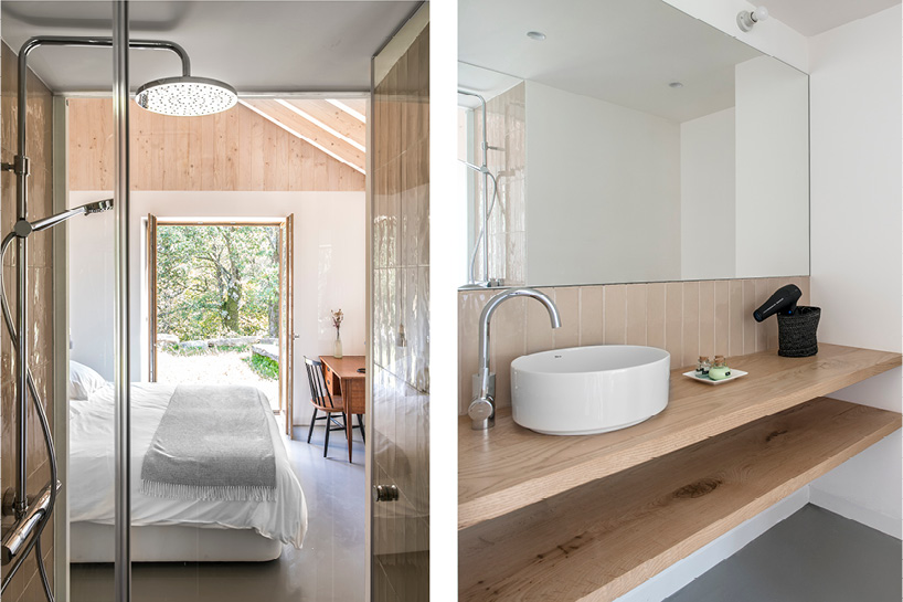 The master bathroom features neutral tiles and natural wooden shelves