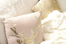 08 a blush pillow with a gold sequin deer is a cute idea for a woodland yet glam touch