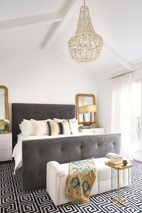 a creamy and grey bedroom is glammed up with brass touches
