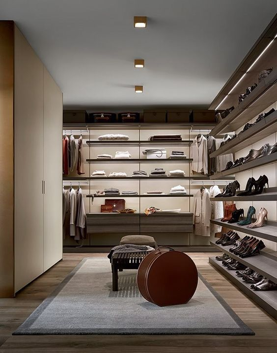 a luxurious modern closet with open shelving and a large wardrobe is great for both men and women
