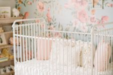 08 a sweet vintage-inspired girl's nursery with a floral statement wall