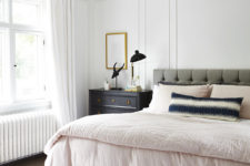 09 The master bedroom is done in neutrals plus grey, and there are some metallic touches for a chic look
