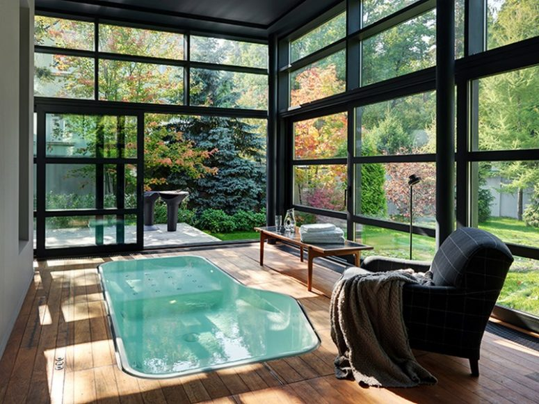 There's a cool bath space with framed glass walls and a jacuzzi, which can be opened to outdoors
