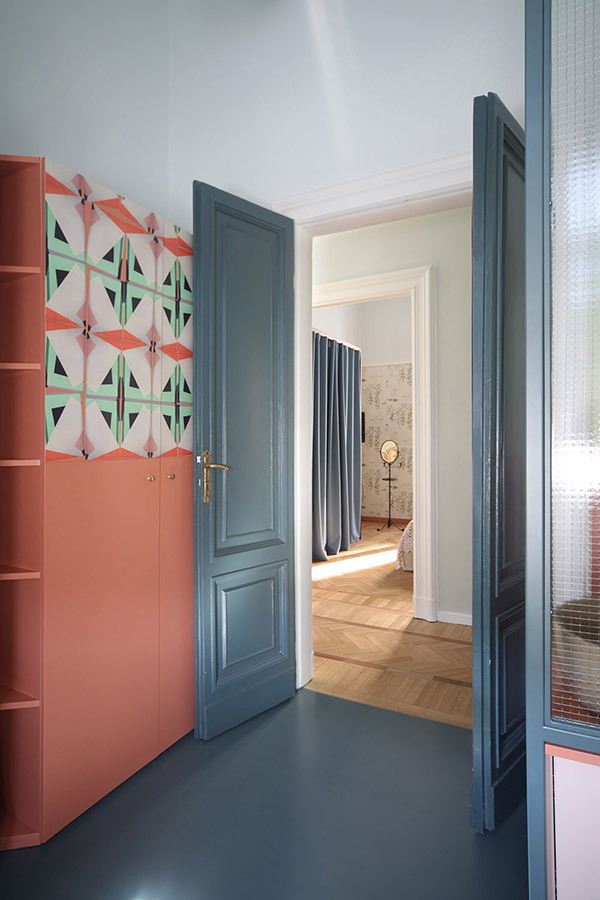 There's a coral wardrobe with bold geometric mosaics to fit the furniture