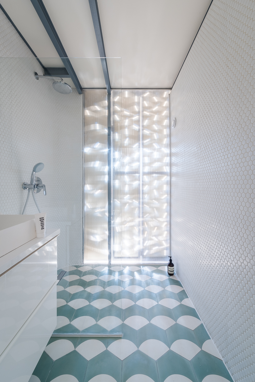 tiles lon a bathroom floor with an interesting pattern