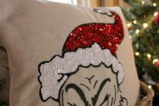 09 a fun Grinch pillow in red and white sequins looks super whimsy and bold and you can make it yourself