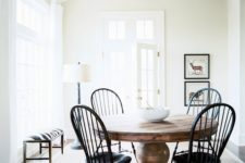 09 a large vintage wood pedestal table and vintage black chairs for an eye-catchy breakfast space